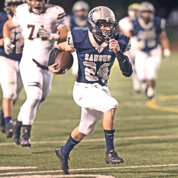 Saugus running back Quinn Sheaffer (24) runs away from defenders to set up a touchdown for Saugus in the first quarter against St. Francis at COC on Friday. Dan Watson/for The Signal